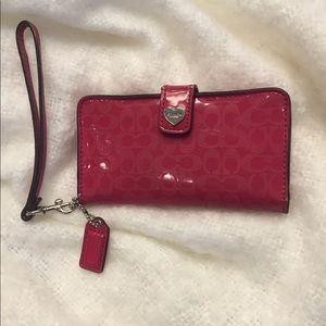 Coach pink patent leather wallet.